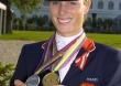 Zara Phillips with her individual gold medal and team silver medal - ©FEI